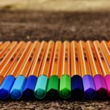 Bunch of coloring markers for adults lying on floor