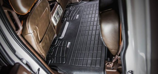 black color all weather car floor mats in a car.