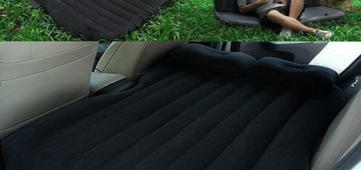A black color inflatable car mattresses lying inside a car.