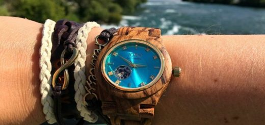 wooden watches for men on the wrist of a man.